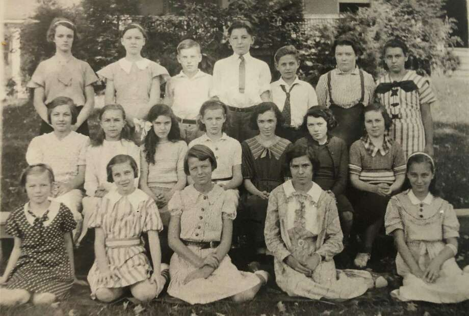 "St. Francis School in New Milford celebrated its first graduating class in 1935. Among the graduates were, from left to right, in front, Geraldine Hulton, Veronica McMahon, Minnie Halpine, Helen Syniec and Lorraine Reynolds; second row, Theresa Raino, Josephine Kozieleic, Beatrice Martin, Phyllis Lawlor, Mary Ward, Shirley Harris and Jeanne Cuddy; and in back, Joan Carson, Mary Dolan, Paul E. Martin, William Moore, Joseph Kracheski, Marjorie Frizzel and Josephine Boucher. If you have a ""Way Back When"" photo you'd like to share, contact Deborah Rose at drose@newstimes.com or 860-355-7324. Photo: Courtesy Of E. Paul Martin's Family / The News-Times Contributed"