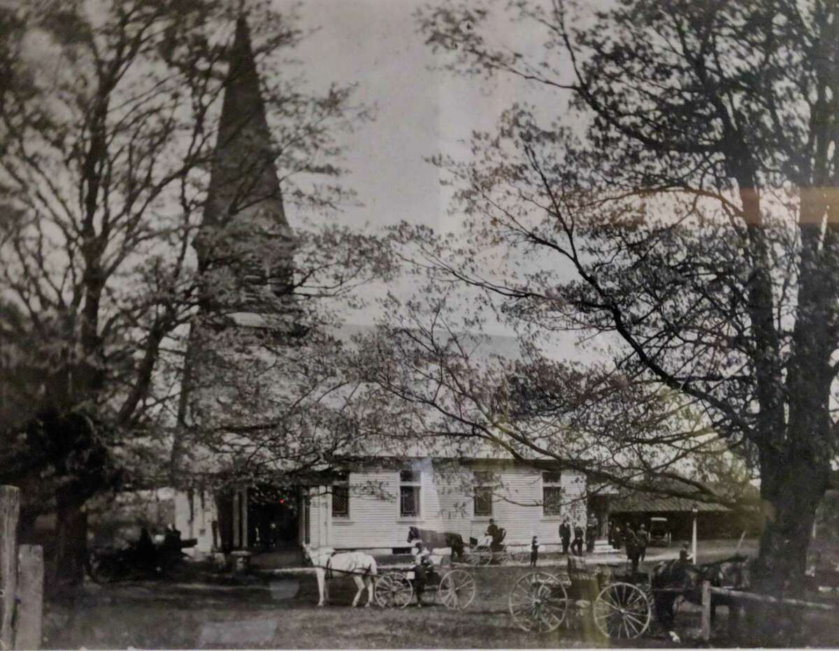 The Sherman Congregational Church is shown above 1914, with carriages bringing the faithful to church.