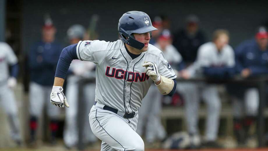 Connecticut's Pat Winkel runs to first base during an NCAA college baseball game against Rhode Island, Tuesday, May 14, 2019, in Kingston, R.I. (AP Photo/Stew Milne) Photo: Stew Milne / Associated Press / Copyright 2019 The Associated Press. All rights reserved.