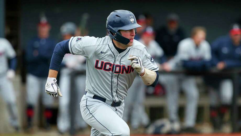 UConn's Pat Winkel runs to first base against Rhode Island in 2019. Photo: Stew Milne / Associated Press / Copyright 2019 The Associated Press. All rights reserved.