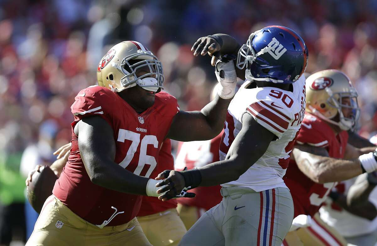 San Francisco 49ers offensive tackle Anthony Davis (76) blocks New York Giants defensive end Jason Pierre-Paul (90) during the second half of an NFL football game in San Francisco, Sunday, Oct. 14, 2012. (AP Photo/Marcio Jose Sanchez)