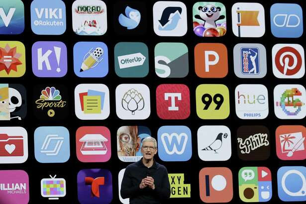 FILE - In this Monday, June 4, 2018 file photo, Apple CEO Tim Cook speaks during an announcement of new products at the Apple Worldwide Developers Conference in San Jose, Calif. Since its debut 10 years ago Tuesday, July 10, 2018, Apple's app store has unleashed new ways for us to work, play, and become lost in our screens. (AP Photo/Marcio Jose Sanchez, File)