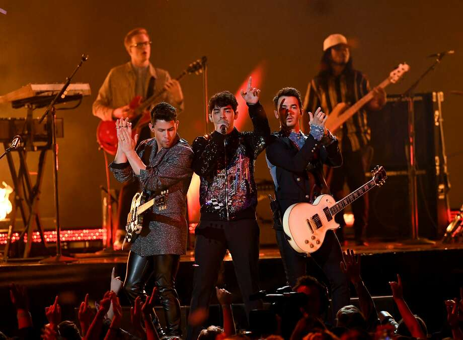 LAS VEGAS, NEVADA - MAY 01: (L-R) Nick Jonas, Joe Jonas, and Kevin Jonas of Jonas Brothers perform onstage during the 2019 Billboard Music Awards at MGM Grand Garden Arena on May 01, 2019 in Las Vegas, Nevada. (Photo by Kevin Winter/Getty Images for dcp) Photo: Kevin Winter, Getty Images For Dcp