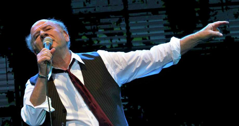 Singer-songwriter Art Garfunkel will share his songs and stories at the Warner Theatre on July 13. Photo: Contributed Photo / AFP/Getty Images / AFP