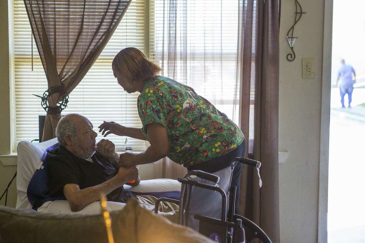 Cynthia Minix helps her husband, John Deason, who recently suffered a stroke, inside their home at the Sandpiper Cove apartments, on March 26, 2019. Minix has been struggling to keep the syringes she uses to feed her husband clean because the sinks inside her home have been repeatedly backing up with wastewater. Residents of the apartment, which are privately owned but receive federal money from HUD, have complained repeatedly about problems with mold, rodents, sewer backups and bed bugs.