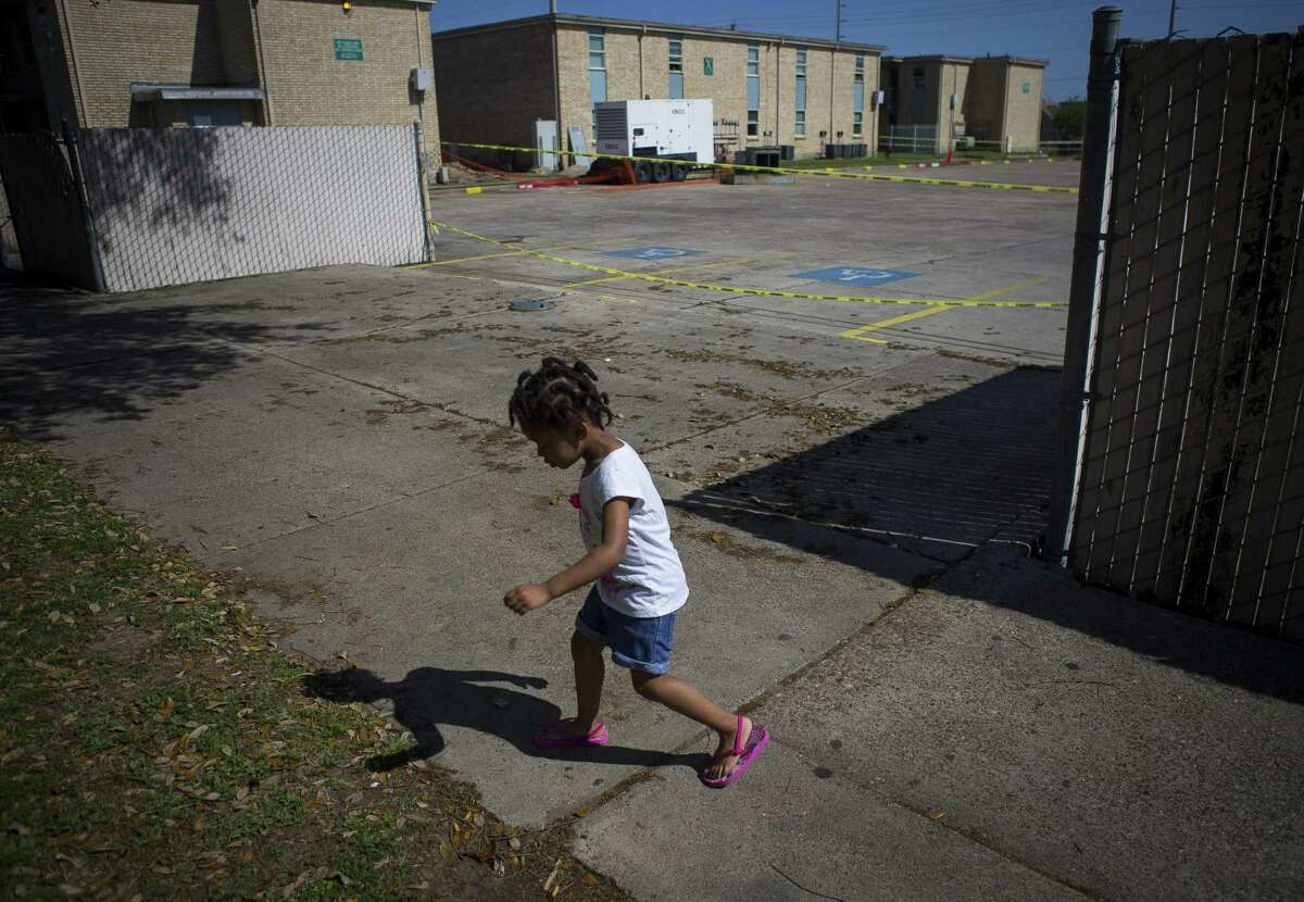 Three-year-old Peyton Johnson plays in front of her home at the Sandpiper Cove apartments, which are privately owned but subsidized by HUD, in Galveston, on March 26, 2019. Residents have complained repeatedly about problems with mold, rodents and sewer backups.