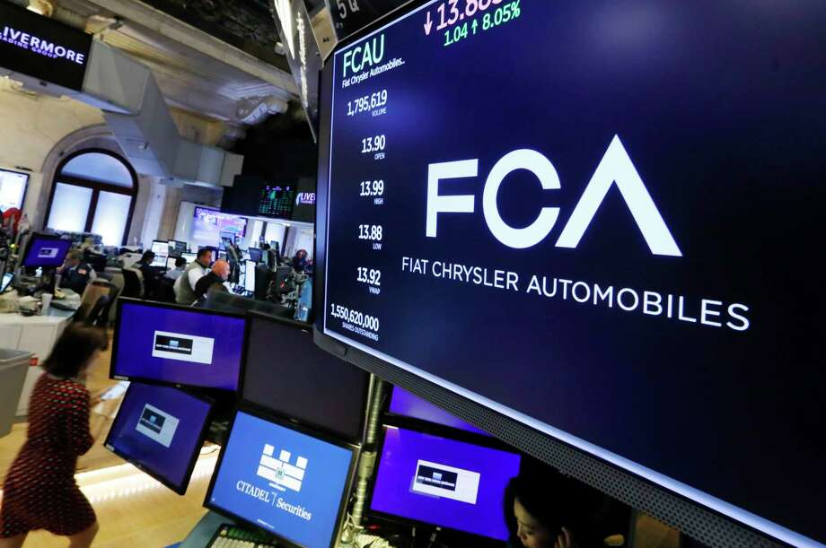 The Fiat Chrysler Automobiles logo appears above a post on the floor of the New York Stock Exchange, Tuesday, May 28, 2019. Fiat Chrysler is proposing a merger with French carmaker Renault aimed at saving billions of dollars for both companies. (AP Photo/Richard Drew) Photo: Richard Drew / Copyright 2019 The Associated Press. All rights reserved.