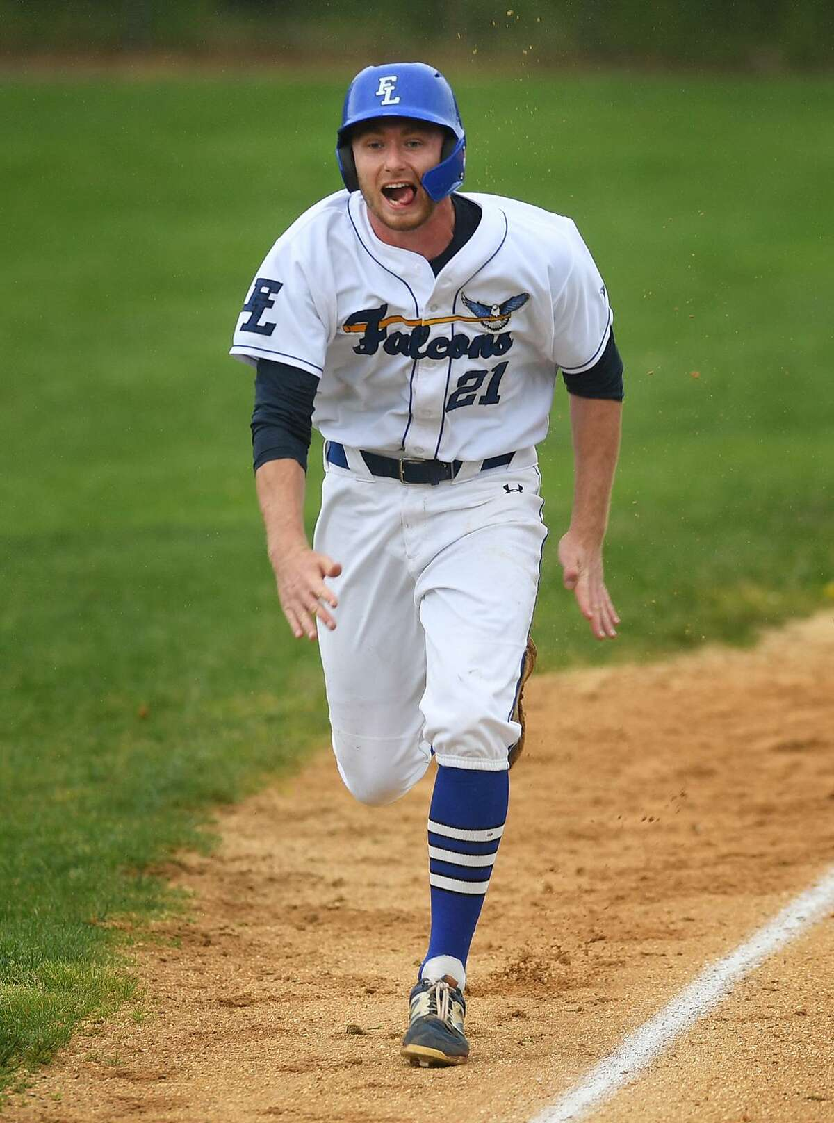 Fairfield Ludlowe's Chris Benton races to the plate to score his team's 4th run of the opening inning of their Class LL baseball playoff game against rival Fairfield Warde in Fairfield, Conn. on Tuesday, May 28, 2019.