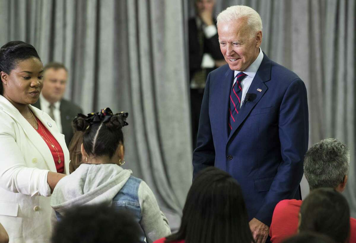 Former Vice President Joe Biden, a 2020 Democratic presidential hopeful, takes a question from Virmania Villalobos, 10, during a town all meeting with a group of educators from the American Federation of Teachers on Tuesday, May 28, 2019, in Houston.