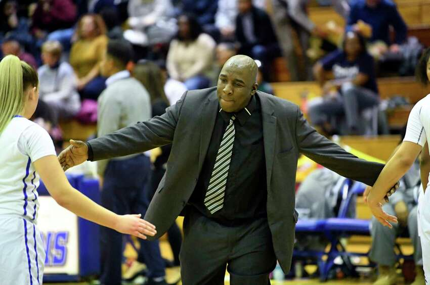 Albany head coach Decky Lawson instructs his players against Averill Park during the first half of a girls high school basketball game Friday, Dec. 7, 2018, in Albany, N.Y.