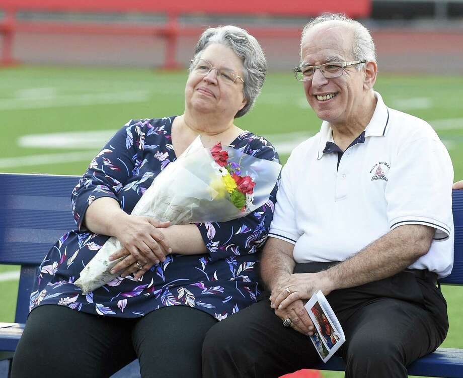 Longtime former Hour sportswriter and columnist George Albano sits with his wife Diane as he is honored with the naming of the pressbox at Brien McMahon High School's Jack Casagrande Field on May 28, 2019 in Norwalk, Connecticut. Photo: Matthew Brown / Hearst Connecticut Media / Stamford Advocate