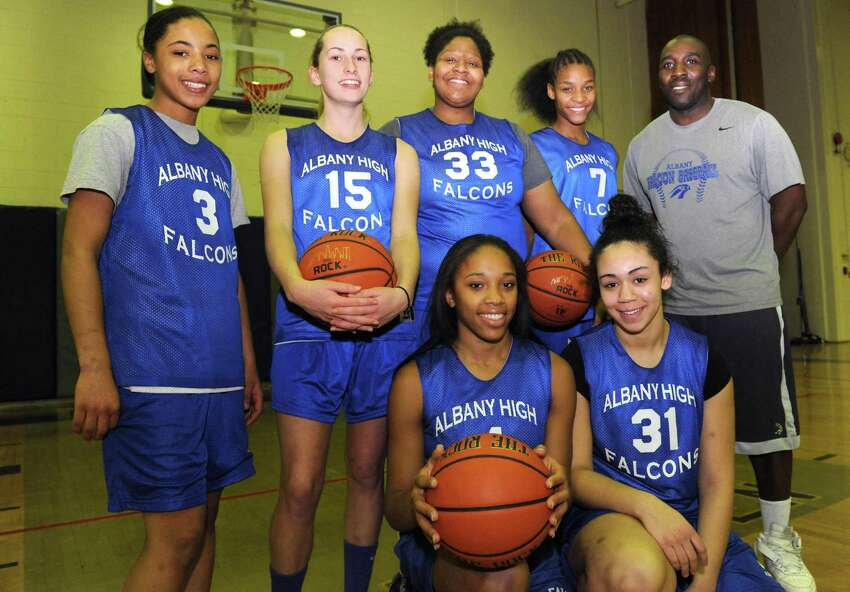 Albany High School girl's basketball starters, left to right Ayanna Hunter, Cara Waterson, Melissa Canty, Mylah Chandler, Emia Willingham Hurst, Ariel Greer and head coach Decky Lawson on Thursday Jan. 24,2013 in Albany, N.Y. Police on Tuesday confirmed the victim of Monday's shooting was Hunter, who was living in Schenectady.(Michael P. Farrell/Times Union)