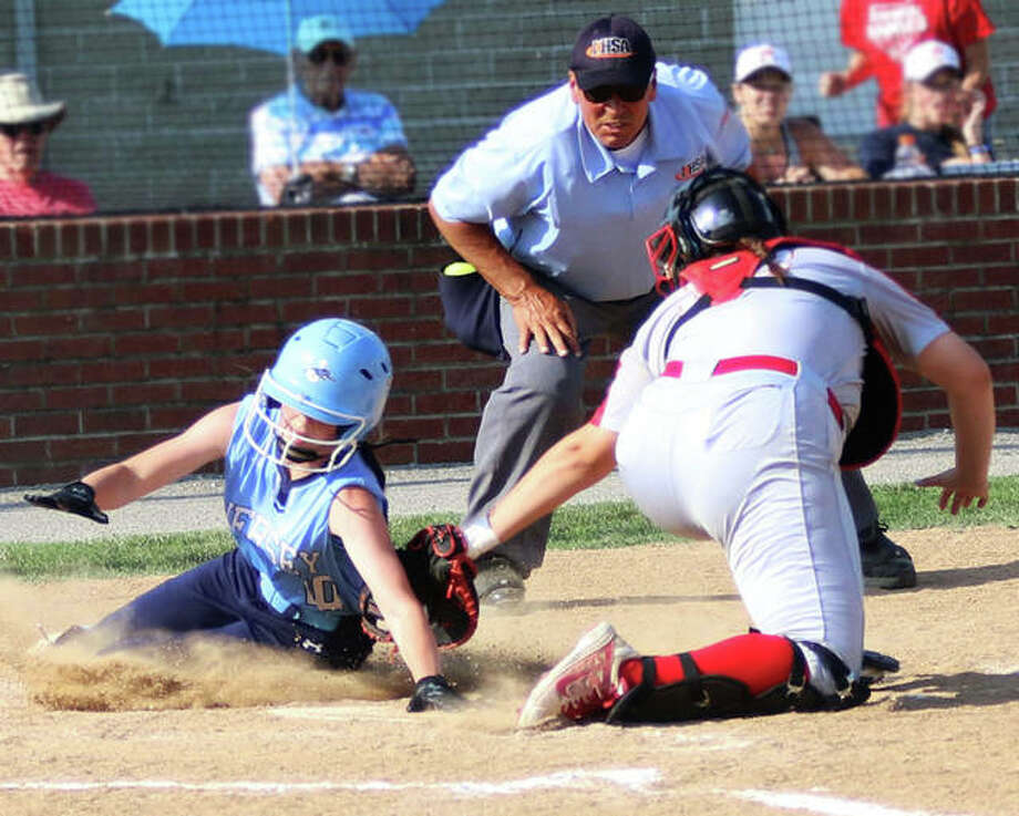 Centralia catcher Taylor Henson, right, tags out Jersey's Sydney Gillis on a play at the plate in the third inning Tuesday in a semifinal softball game at the Carterville Class 3A Sectional. Photo: Greg Shashack | The Telegraph