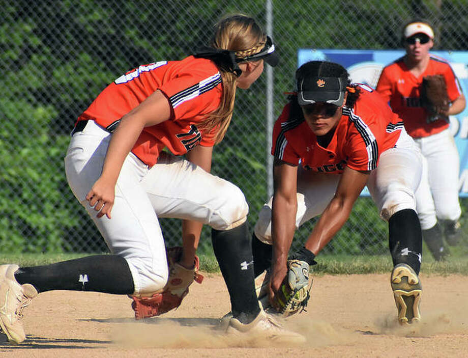 Edwardsville shortstop Maria Smith, right, fields a ball next to third baseman Lexi Gorniak on Tuesday in the Class 4A Normal Community Sectional semifinal in Belleville. Photo: Matt Kamp | For The Telegraph