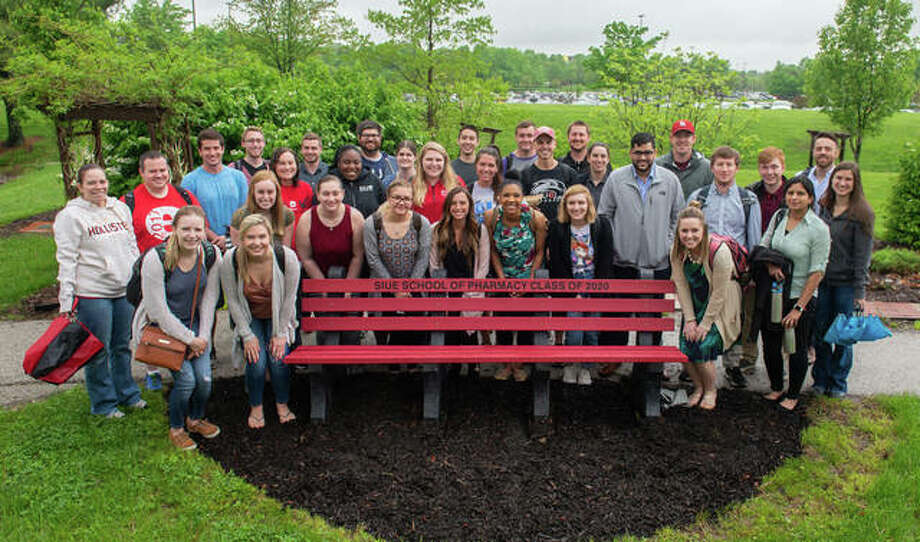The School of Pharmacy Class of 2020 surrounds the bench made of recycled bottle caps that they donated to the School and had installed by the Medicinal Garden. Photo: For The Intelligencer