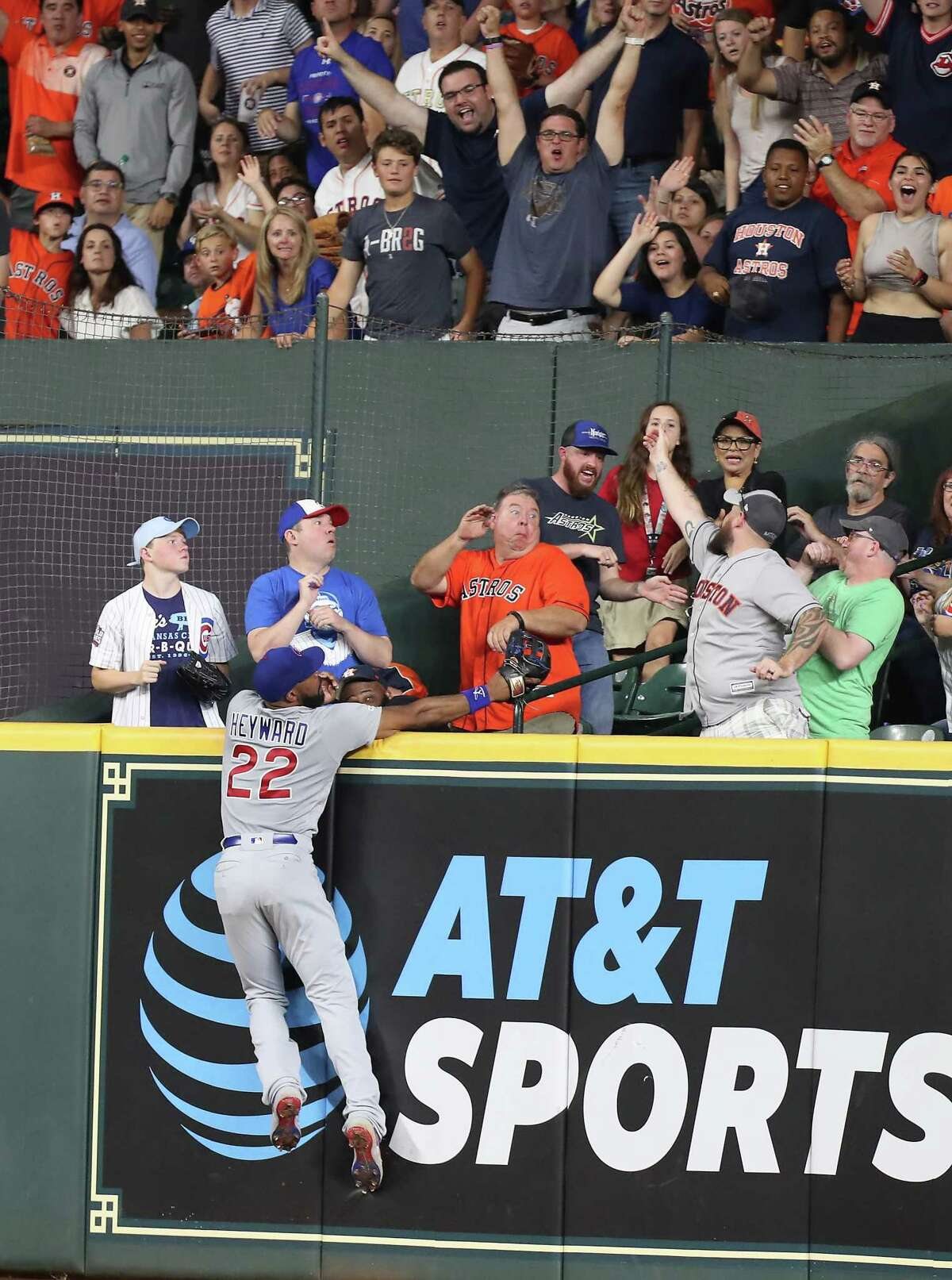 Chicago Cubs right fielder Jason Heyward (22) could reach Houston Astros third baseman Alex Bregman (2) homer during the 6th-inning of an MLB baseball game at Minute Maid Park Tuesday, May 28, 2019, in Houston.