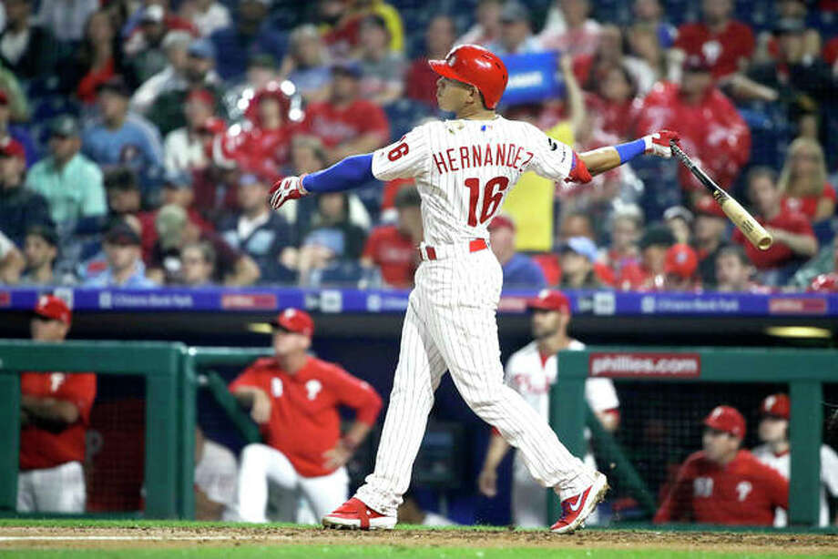 The Phillies' Cesar Hernandez follows through after hitting a home run in the fourth inning of Tuesday night's game against the Cardinals in Philadelphia. Photo: AP Photo