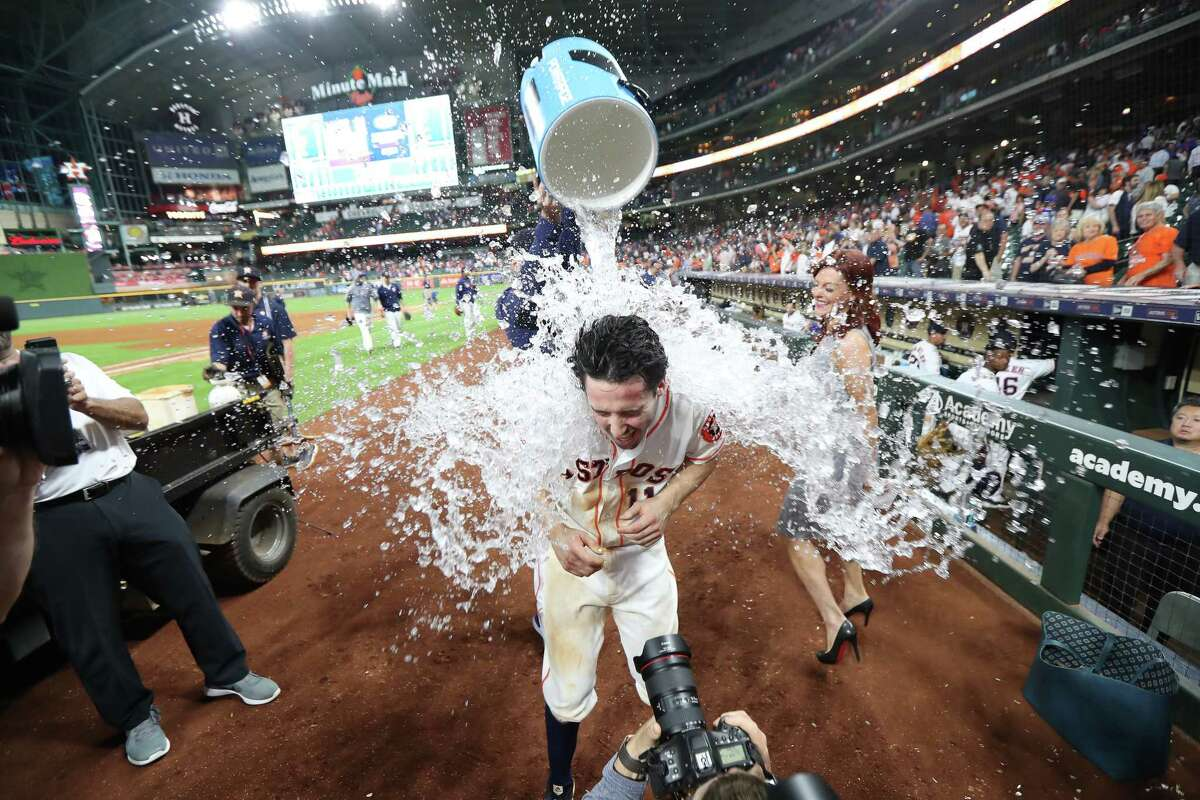 Astros catcher Garrett Stubbs has a water cooler dumped on him by Lance McCullers Jr. after a victory over the Cubs in Stubbs' MLB debut Tuesday at Minute Maid Park.