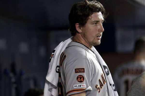 San Francisco Giants starting pitcher Derek Holland looks from the dugout after pitching in the sixth inning during a baseball game against the Miami Marlins, Tuesday, May 28, 2019, in Miami. (AP Photo/Lynne Sladky)