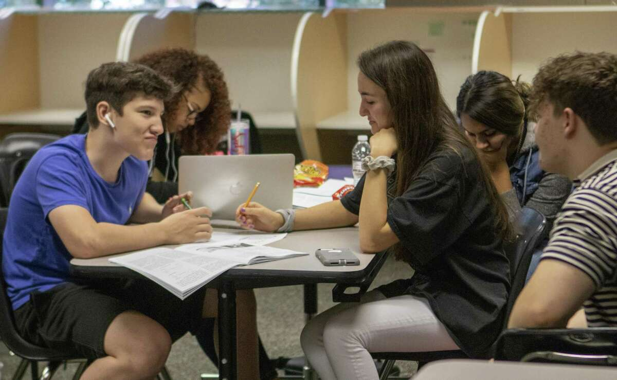 Students in iSchool High work through textbooks Wednesday, May 22, 2019 at Lone Star College - Montgomery in The Woodlands.