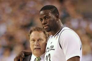 Michigan State head coach Tom Izzo talks with forward Draymond Green during the second half against Butler in a men's NCAA Final Four semifinal college basketball game Saturday, April 3, 2010, in Indianapolis. (AP Photo/Mark J. Terrill)