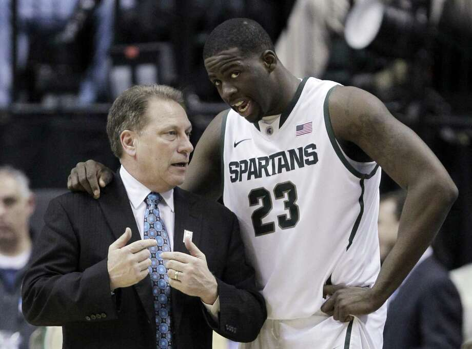 Michigan State head coach Tom Izzo talks to Michigan State forward Draymond Green (23) in the first half of an NCAA college basketball game against Iowa in the second round of the Big Ten Conference tournament in Indianapolis, Friday, March 9, 2012. (AP Photo/Michael Conroy) Photo: Michael Conroy / AP / AP