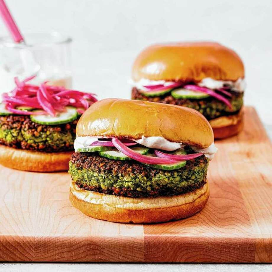 Falafel Burgers with Tahini-Yogurt Sauce puts a unique spin on the classic American burger. Photo: Daniel J. Van Ackere | America's Test Kitchen Via AP