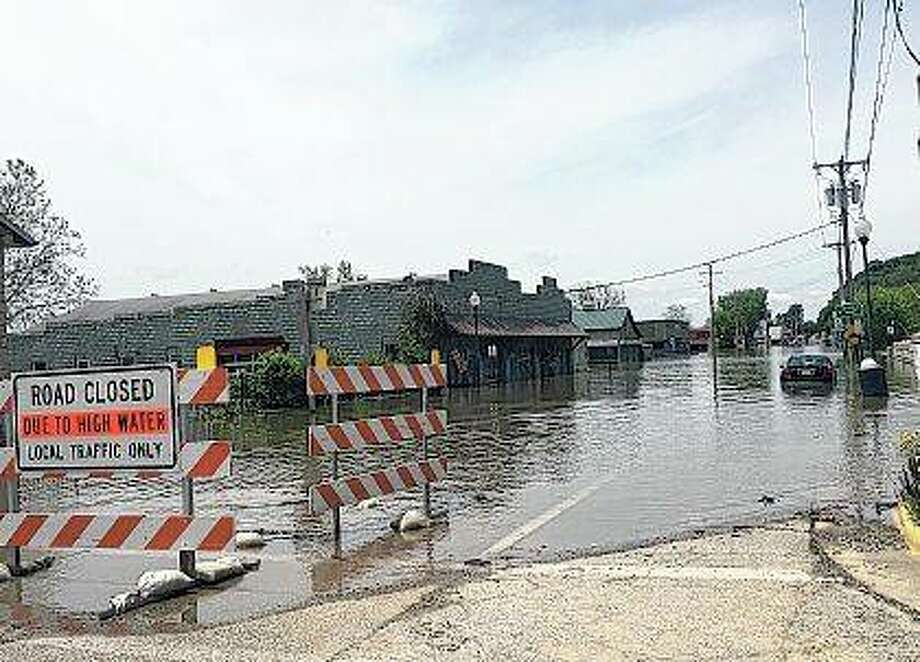 High water has taken over portions of Grafton, and forecasters say more rain this week could drive river levels higher. Photo: Joy Harris | Reader Photo