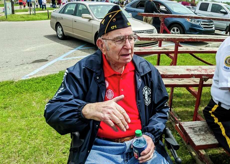 Richard Roehrs, 93, believed to be the oldest active Gladwin County veteran, visited with friends before the annual Memorial Day ceremony in Ross Lake Park, in front of the memorial he helped erect, on Monday, May 27, 2019. (Tereasa Nims/for the Daily News)