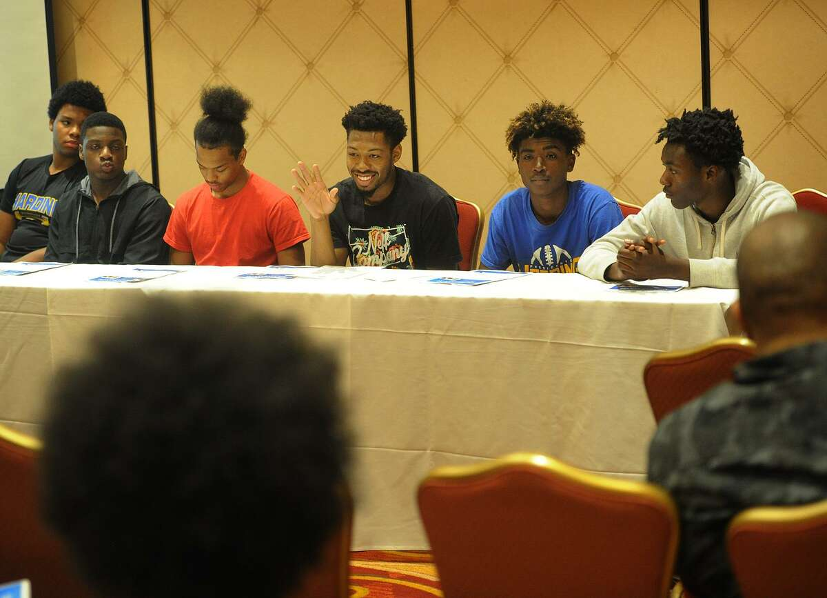 From left; Bridgeport high school students Troy Rainey, 15, Karlshon Fleming, 16, Xavien Reid, 16, Jordan Gallimore, 17, Knazier Clarke, 15, and Jaharie Mack, 17, sit on a Males of Color panel at the Educators for Excellence forum at the Trumbull Marriott in Trumbull, Conn. on Wednesday, May 23, 2018.