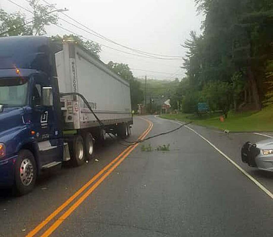 A tractor-trailer that took down some wires has closed Route 39 in Sherman on Wednesday, May 29, 2019. Photo: Sherman Resident State Trooper / Facebook