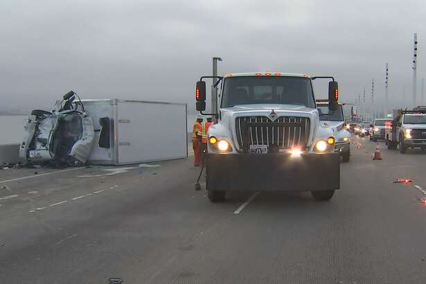 At least one person has died and four others were injured following a collision between a box truck and a bus on the Bay Bridge just west of the toll plaza early Wednesday morning.