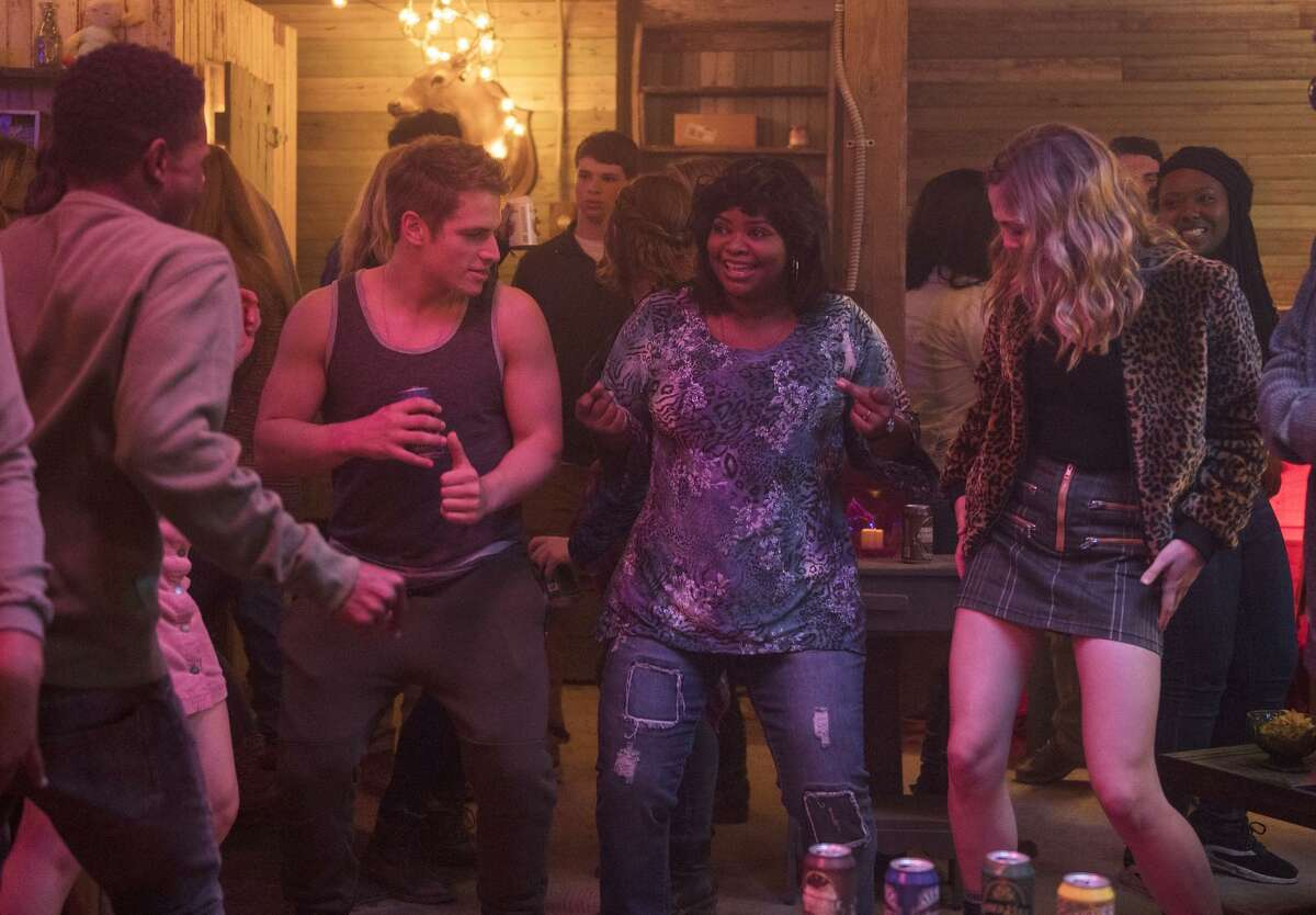 """This image released by Universal Pictures shows, from left, Dante Brown, Gianni Paolo, Octavia Spencer and McKaley Miller in a scene from """"Ma."""" (Anna Kooris/Universal Pictures via AP)"""