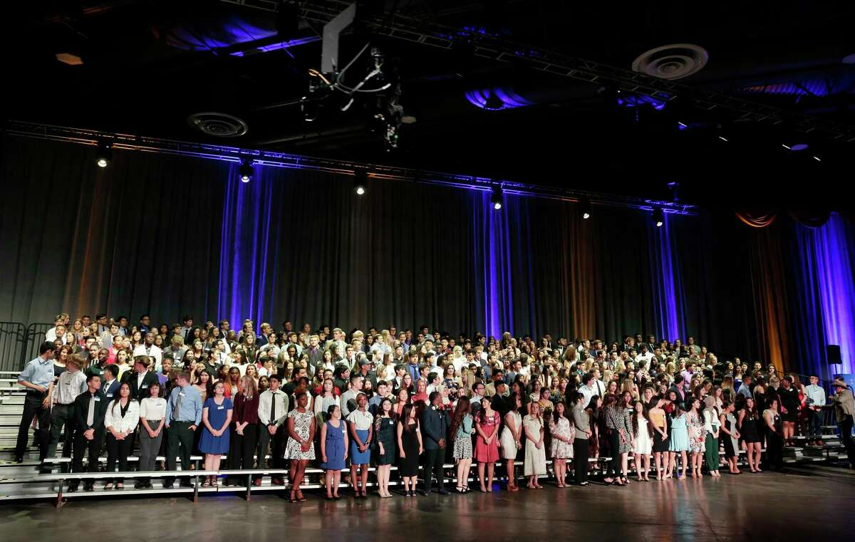 Over 400 student recipients of the scholarships pose on risers for a photo during the Houston Livestock Show and Rodeo Scholarship Banquet at the NRG Center Wednesday, May. 22, 2019 in Houston, TX.