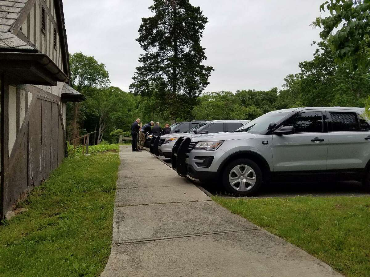 State and New Canaan police meet at the Carriage Barn in Waveny Park, where they continued the search for missing mother Jennifer Dulos on Wednesday, May 29.