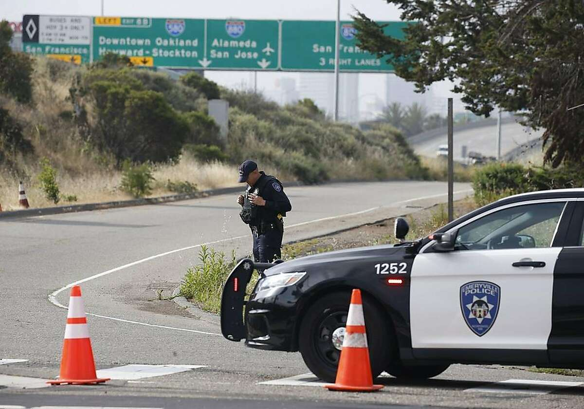 A police officer closes an on-ramp to Interstate 80 at Powell Street in Emeryville, Calif. on Wednesday, May 29, 2019 following a fatal accident on the Bay Bridge which forced the closure of three lanes during the morning commute.