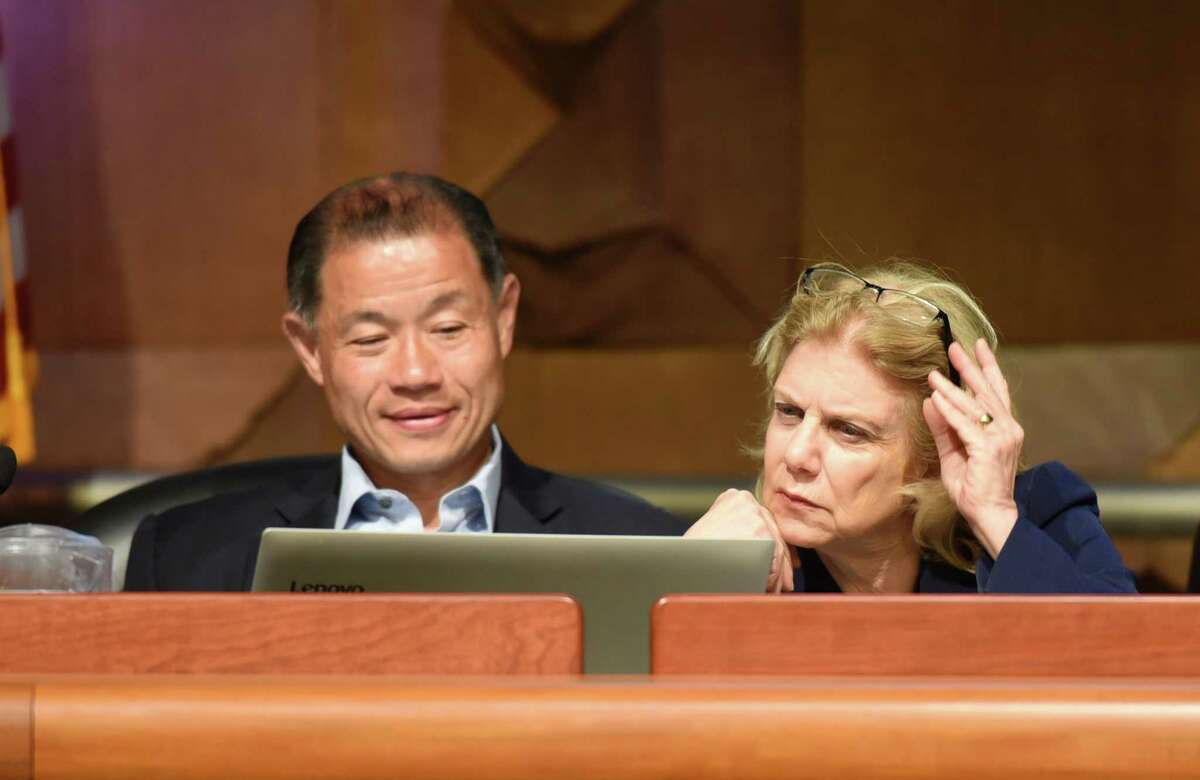 Senator John Liu and Senator Shelley Mayer share a laptop to look over Daniel Thatcher's presentation during a hearing on New York State school finances and alternative options on Wednesday, May 29, 2019 at the Legislative Office Building in Albany, NY. (Phoebe Sheehan/Times Union)