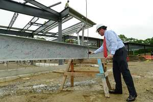 Board of Education member Mike Barbis participates in a Topping Off Ceremony Wednesday, May 29, 2019, that marked the next phase of construction and development for the K-8 Ponus Ridge STEAM Academy at Ponus Ridge Middle School in Norwalk, Conn.