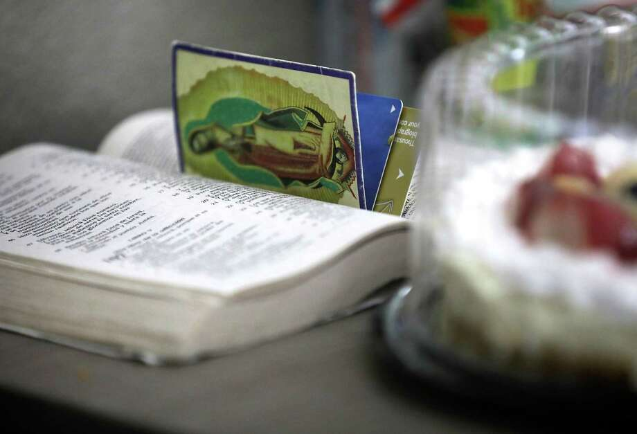 Until recently, Escobar was staying at a hotel wedged between a Bill Miller Bar-B-Q and an IHOP with two other transgender women who won their asylum claims and were released from the Pearsall detention center Escobar brings the Bible wherever she goes and relies on donated food, like this cake. Photo: Bob Owen /Staff Photographer / ©2019 San Antonio Express-News