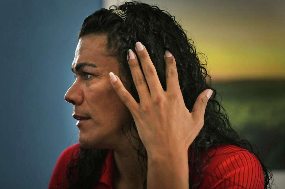 "When transgender migrant Jennifer Mariena, 45, of Honduras, was released from detention, RAICES took her to a room where she could try on donated clothes and put on makeup. . ""I said this is me, not the woman that was in Pearsall,"" she says. Photo: Bob Owen /Staff Photographer / ©2019 San Antonio Express-News"
