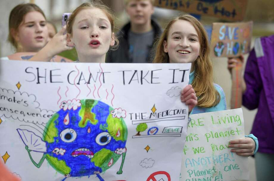 Several hundred students from Greenwich Country Day School march to Greenwich Town Hall in March to call for more action on climate change at the local, state and federal level. Photo: Matthew Brown / Hearst Connecticut Media / Stamford Advocate