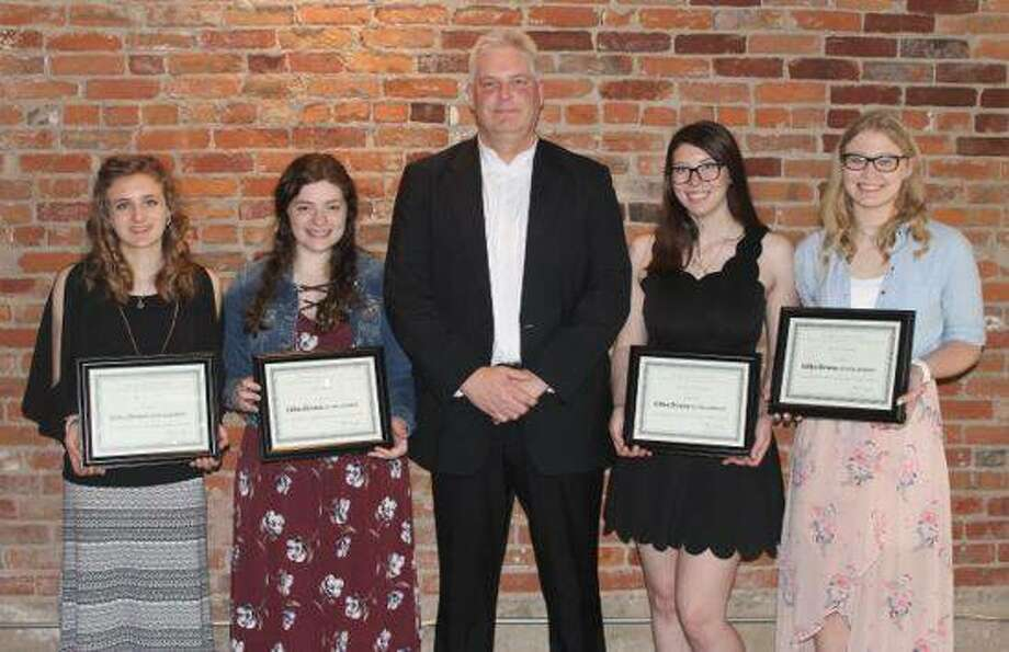 Olin Brass President Dale Taylor, center, recently helped honor this year's Olin Brass Scholarship receipients, from left, Michal Miller, Emily Pipkin, Brooklyn Wigger and Rebecca Roth.