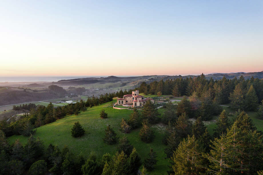 On an 186-acre slice of bucolic countryside an hour from San Francisco, this ocean-view Pescadero ranch features a 5,100-acre estate, a cattle barn, three ponds stocked with catfish, a willow-shaded stream and gently rolling hills as far as the eye can see. Photo: California Outdoor Properties / Drone Cowboys