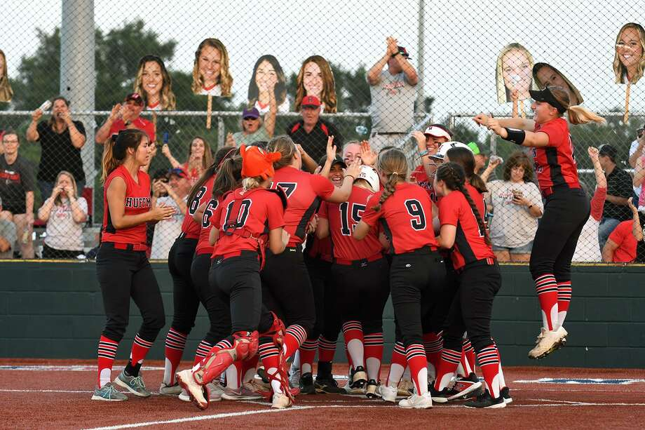 Huffman sophomore Hagen Pike, right, and her teammates congratulate junior outfielder Kenzie Gates (15) as she touches home plate after homering against Robinson in the top of the 4th inning of Game One of their Region III-4A Final Playoff Series at Madisonville High School on May 23, 2019. Photo: Jerry Baker, Houston Chronicle / Contributor / Houston Chronicle