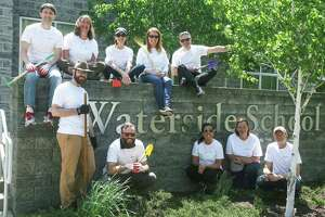 Members from The Southfield Center for Development helped beautify the grounds of the Waterside School in Stamford on May 22.