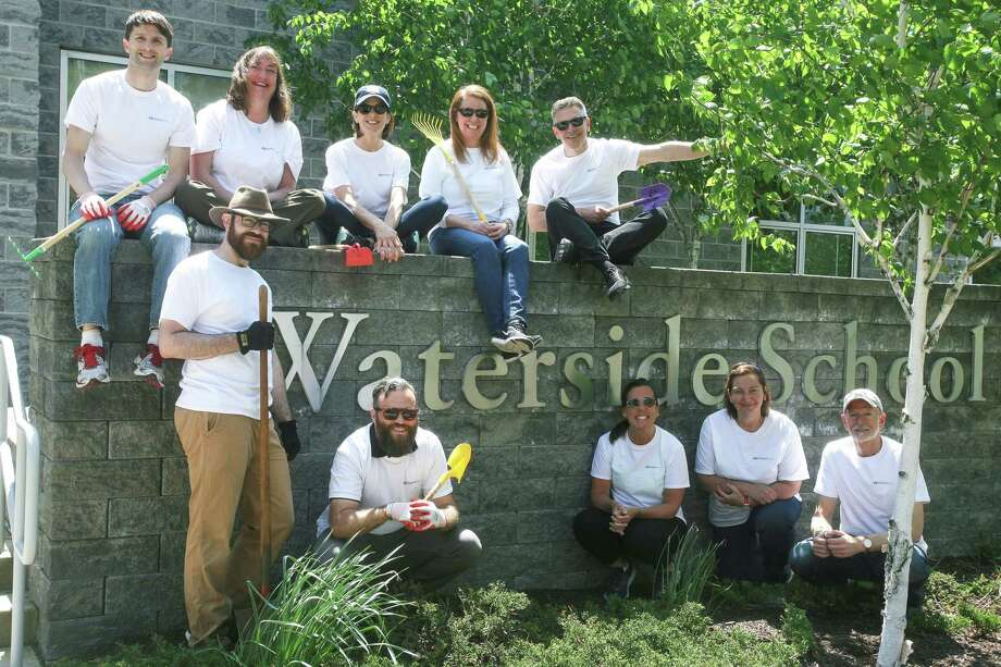Members from The Southfield Center for Development helped beautify the grounds of the Waterside School in Stamford on May 22. Photo: Karen Seelert / Contributed Photo / Westport News contributed