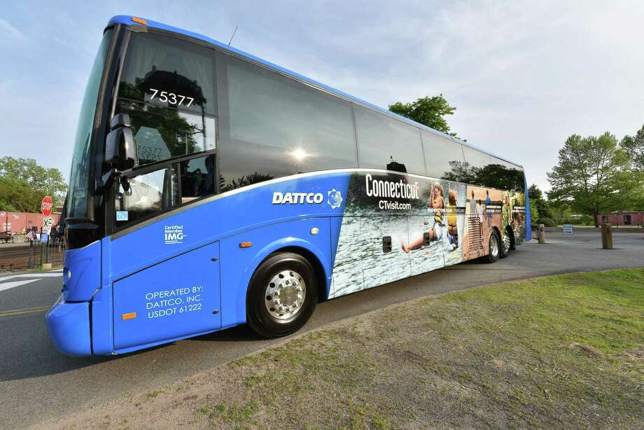 Two DATTCO motor coaches featuring photos of central Connecticut tourism attractions and the state's tourism website were unveiled last week at the Essex Steam Train and Riverboat in Essex. Photo: Contributed Photo