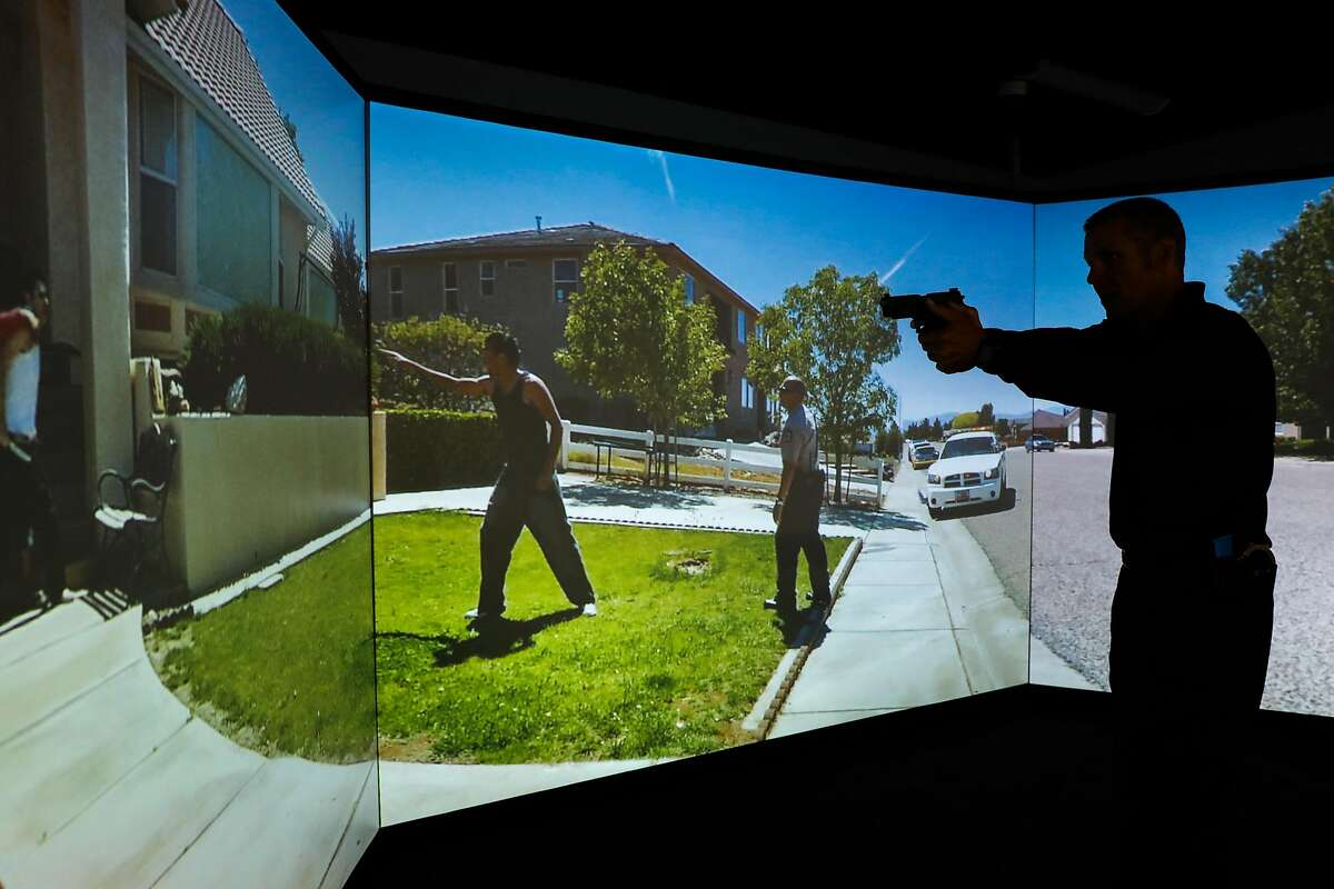 Sgt. Steven Pomatto of the San Francisco Police Department demonstrates how he teaches use-of-force training using the VirTra simulator in San Francisco, California, on Monday, Sept. 17, 2018. The VirTra puts cadets and officers in 360-degree scenarios and also has the ability to use real-world locations.
