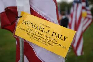 Individual flags are dedicated in the names of veterans, including World War 2 Medal of Honor winner Michael J. Daly, at Field of Valor, a display of 110 American flags at Jennings Park on the Post Road in Fairfield, Conn. on Sunday, November 5, 2017. The display, which Kiwanis plans to continue as an annual event, had an opening ceremony at 1 p.m. on Sunday.