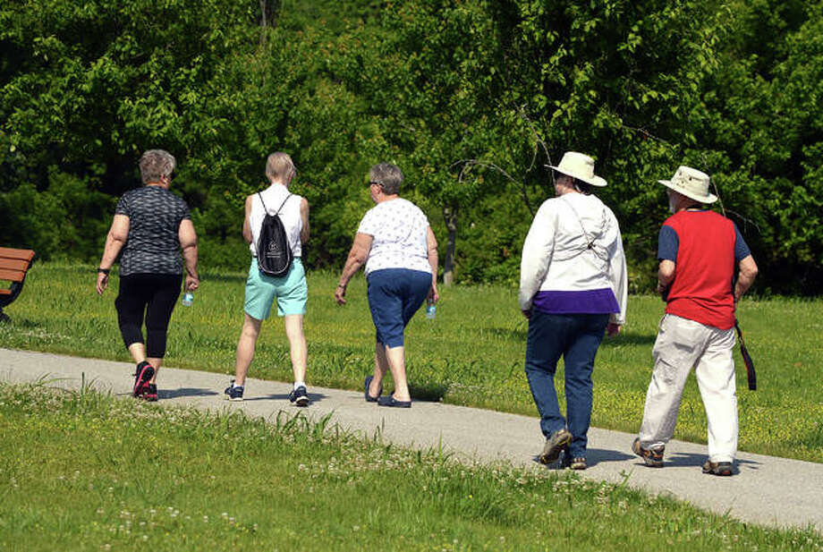 Members of the Walking Club from Main Street Community Center start their hike on Tuesday at Ray M. Schon Park in Glen Carbon. Photo: Scott Marion | The Intelligencer